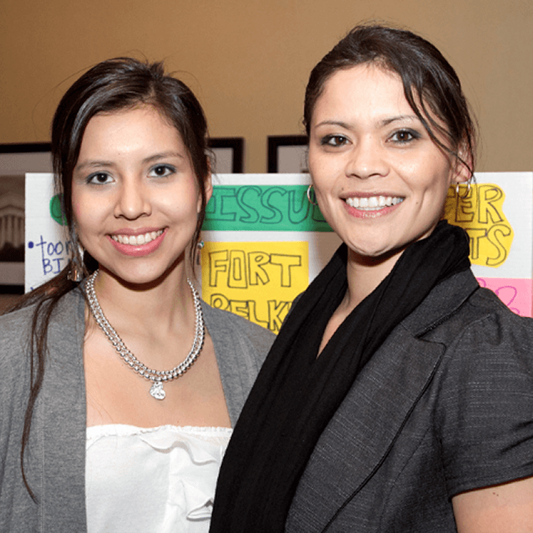 Young American Indian females smiling in front of their tribal proposals