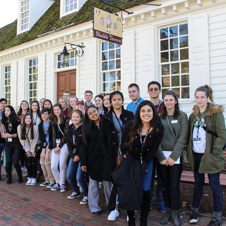 High school students waiting in line in front of Shield's Tavern in Williamsburg, VA
