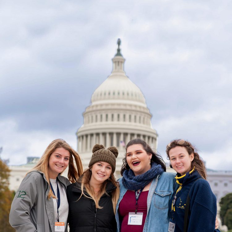 High school girls smiling in front of US Capitol Building