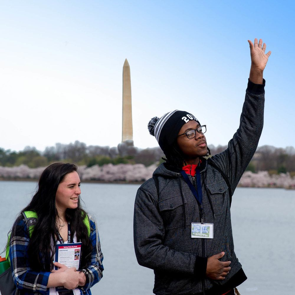 students at tidal basin cherry blossom Washington monument